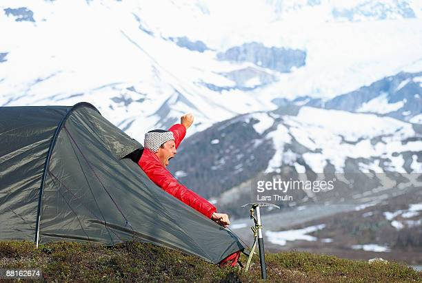 a yawning man in a tent norway. - funny wake up stock pictures, royalty-free photos & images