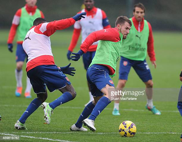 Yaya Sanogo and Aaron Ramsey of Arsenal during a training session at London Colney on December 2 2014 in St Albans England