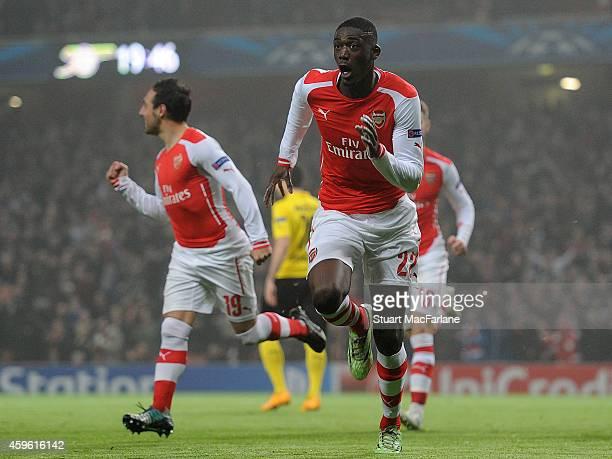 Yaya Sanogo celebrates scoring for Arsenal during the UEFA Champions League match between Arsenal and Borussia Dortmund at Emirates Stadium on...