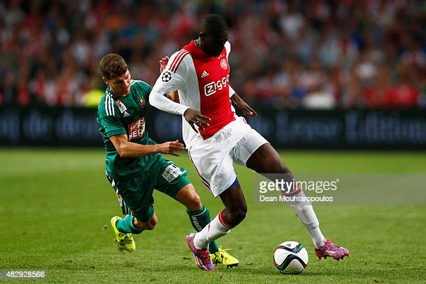 Yaya Sanogo of Ajax battles for the ball with Stephan Auer of Rapid Wien during the third qualifying round 2nd leg UEFA Champions League match...