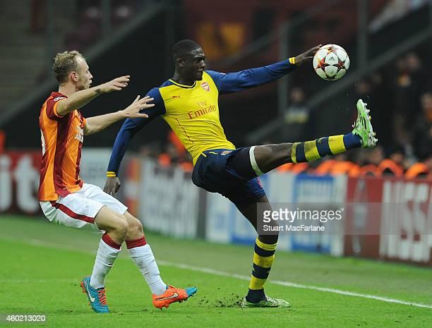 Yaya Sanogo of Arsenal challenged by Semih Kaya of Galatasaray during the UEFA Champions League match between Galatasaray and Arsenal at the Turk...