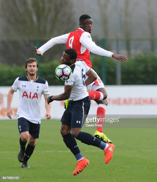 Yaya Sanogo of Arsenal jumps for the ball with Japhet Tanganga of Tottenham during the match between Arsenal U23 and Tottenham Hotspur U23 at London...