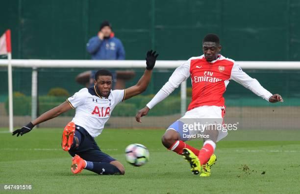Yaya Sanogo of Arsenal shoots under pressure from Japhet Tanganga of Tottenham during the match between Arsenal U23 and Tottenham Hotspur U23 at...