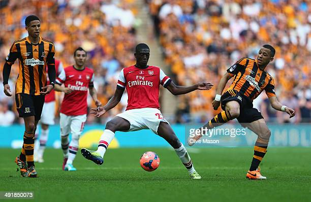 Yaya Sanogo of Arsenal take on Liam Rosenior and Curtis Davies of Hull City during the FA Cup with Budweiser Final match between Arsenal and Hull...
