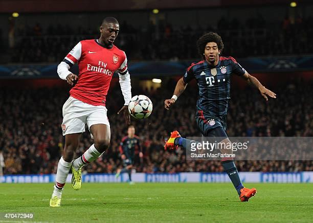 Yaya Sanogo of Arsenal takes on Dante of Bayern Munich during the UEFA Champions League match between Arsenal and FC Bayern Muenchen at Emirates...