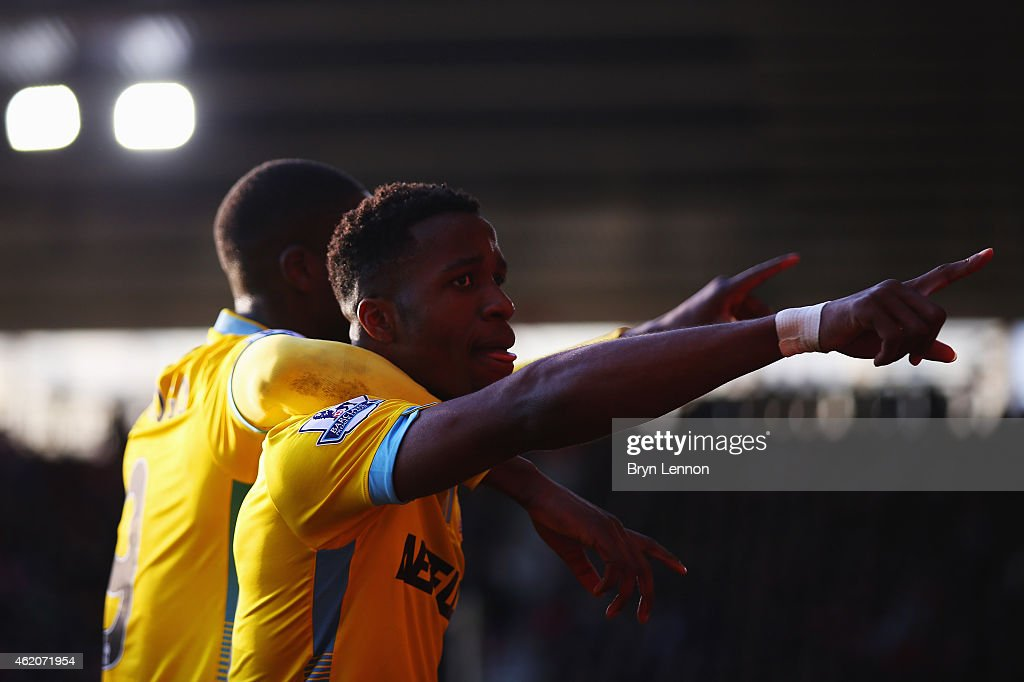 Yaya Sanogo of Crystal Palace (L) celebrates with Wilfried Zaha as he scores their second goal during the FA Cup Fourth Round match between Southampton and Crystal Palace at St Mary's Stadium on January 24, 2015 in Southampton, England.