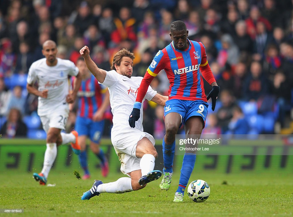 Yaya Sanogo of Crystal Palace is tackled by Niko Kranjcar of QPR during the Barclays Premier League match between Crystal Palace and Queens Park Rangers at Selhurst Park on March 14, 2015 in London, England.