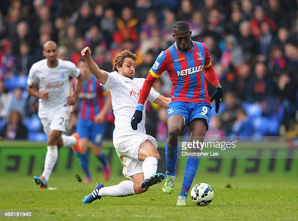 Yaya Sanogo of Crystal Palace is tackled by Niko Kranjcar of QPR during the Barclays Premier League match between Crystal Palace and Queens Park...