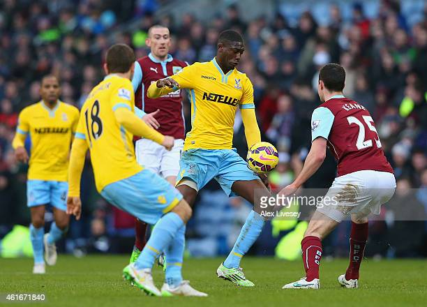Yaya Sanogo of Crystal Palace looks to go past Michael Keane of Burnley during the Barclays Premier League match between Burnley and Crystal Palace...