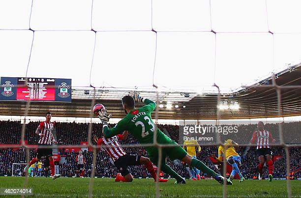 Yaya Sanogo of Crystal Palace shoots past Fraser Forster of Southampton to score their second goal during the FA Cup Fourth Round match between...