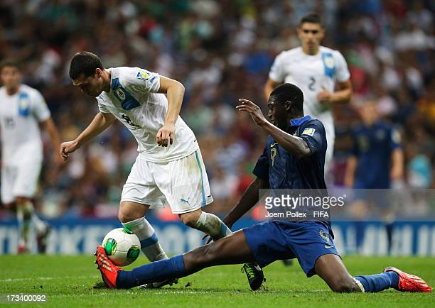 Yaya Sanogo of France and Sebastian Cristoforo of Uruguay compete for the ball during the FIFA U20 World Cup Final match between France and Uruguay...