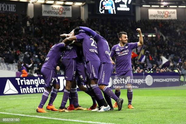 Yaya Sanogo of Toulouse celebrates with his teamates after scoring his side s second goal during the Ligue 1 match between Toulouse and Strasbourg at...