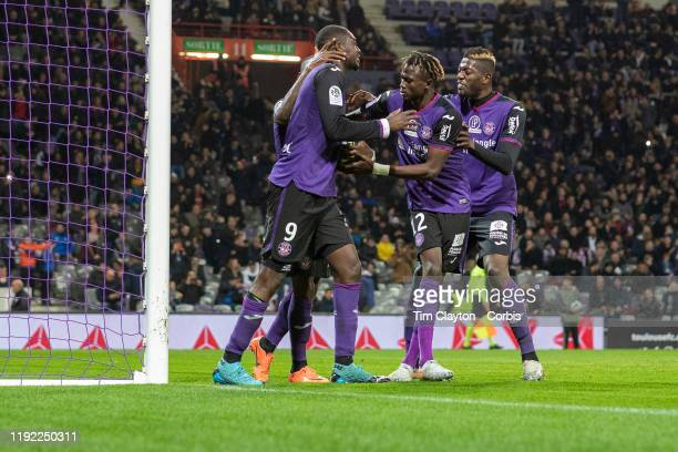December 04: Yaya Sanogo of Toulouse is congratulated by team mates after scoring from the penalty spot during the Toulouse FC V AS Monaco, French...