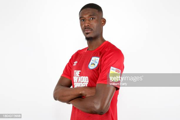 Yaya Sanogo poses for a photo after signing for Huddersfield Town at PPG Canalside on February 25, 2021 in Huddersfield, England.