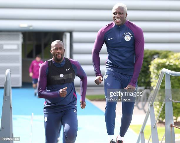 Yaya Toure and Benjamin Mendy walk to training at Manchester City Football Academy on August 24 2017 in Manchester England