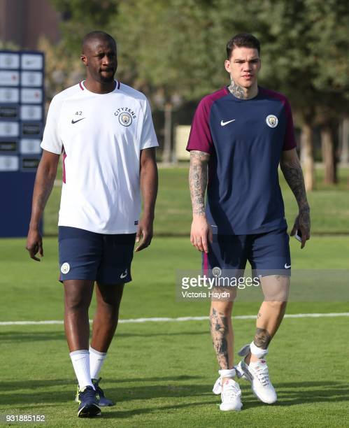 Yaya Toure and Ederson Moraes of Manchester City during the Abu Dhabi Warm Weather Training Camp on March 13 2018 in Abu Dhabi United Arab Emirates