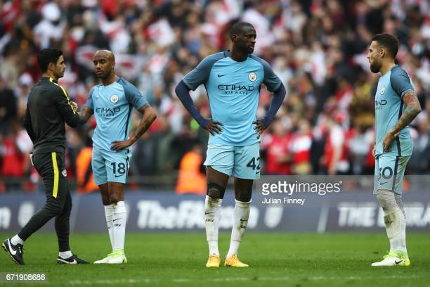 Yaya Toure and Manchester City players show their dejection after the Emirates FA Cup SemiFinal match between Arsenal and Manchester City at Wembley...