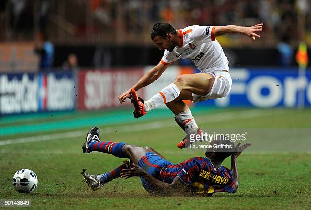 Yaya Toure of Barcelona battles with Razvan Rat of Shakhtar Donetsk during the UEFA Super Cup Final between FC Barcelona and Shakhtar Donetsk at The...
