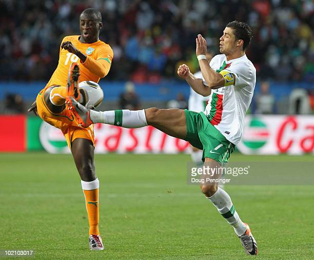 Yaya Toure of Ivory Coast and Cristiano Ronaldo of Portugal challenge for the ball during the 2010 FIFA World Cup South Africa Group G match between...