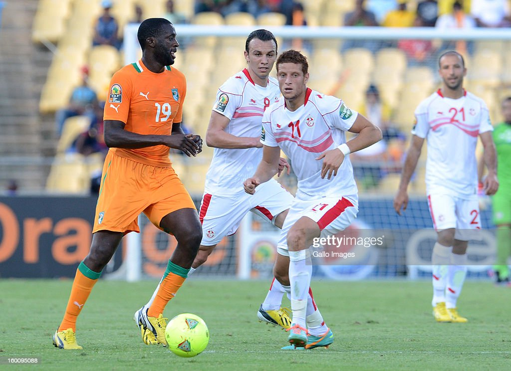 Yaya Toure of Ivory Coast and Fakhreddine Ben Youssef of Tunisia (R)during the 2013 African Cup of Nations match between Ivory Coast and Tunisia at Royal Bafokeng Stadium on January 26, 2013 in Rustenburg, South Africa.