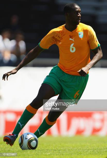 Yaya Toure of Ivory Coast runs the ball during the Japan v Ivory Coast International Friendly match at Stade de Toubillon on June 4, 2010 in Sion,...