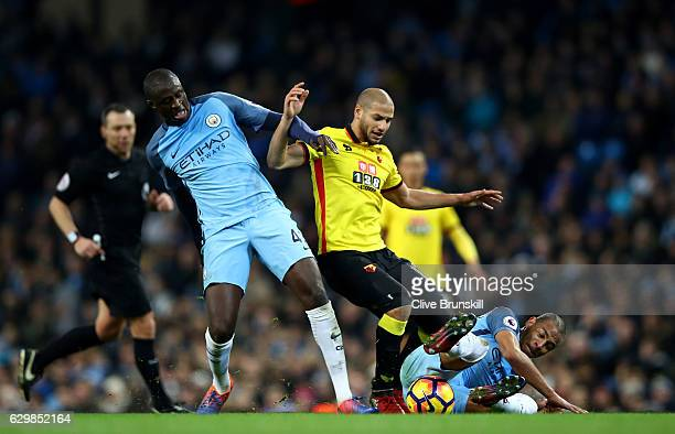 Yaya Toure of Manchester City and Adlene Guedioura of Watford and Fernando of Manchester City battle for possession during the Premier League match...