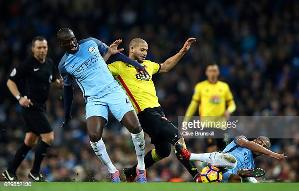 Yaya Toure of Manchester City and Adlene Guedioura of Watford battle for possession during the Premier League match between Manchester City and...