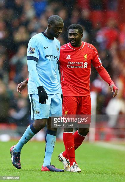 Yaya Toure of Manchester City and Kolo Toure of Liverpool walk off the pitch following the final match during the Barclays Premier League match...