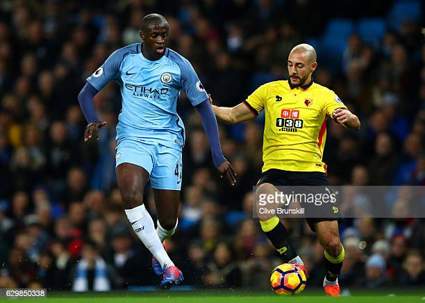 Yaya Toure of Manchester City and Nordin Amrabat of Watford battle for possession during the Premier League match between Manchester City and Watford...