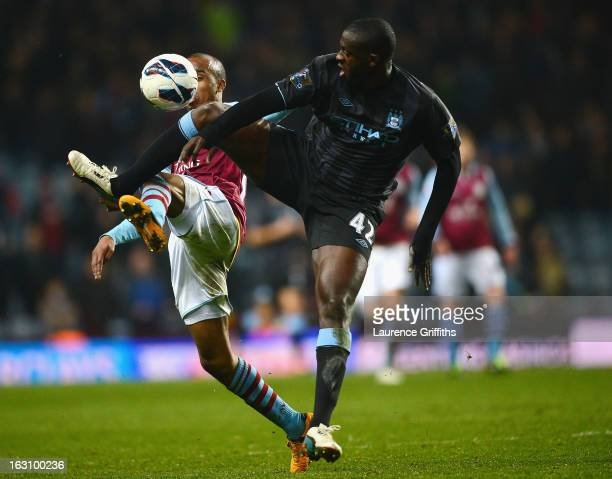 Yaya Toure of Manchester City battles with Fabian Delph of Aston Villa during the Barclays Premier League match between Aston Villa and Manchester...