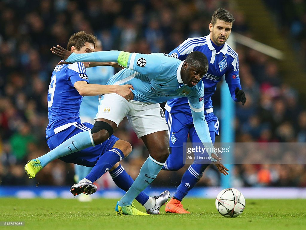 Yaya Toure of Manchester City beats Denys Garmash (L) and Miguel Veloso of Dynamo Kiev (R) during the UEFA Champions League round of 16 second leg match between Manchester City FC and FC Dynamo Kyiv at the Etihad Stadium on March 15, 2016 in Manchester, United Kingdom.