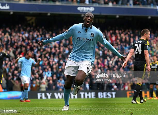 Yaya Toure of Manchester City celebrates after scoring the opening goal during the Barclays Premier League match between Manchester City and Chelsea...