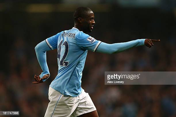 Yaya Toure of Manchester City celebrates after scoring the third goal from a free kick during the Capital One Cup third round match between...