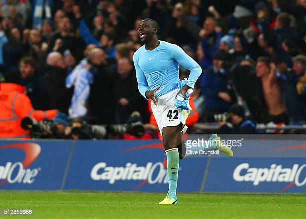 Yaya Toure of Manchester City celebrates as he scores the winning penalty to win the shoot out during the Capital One Cup Final match between...