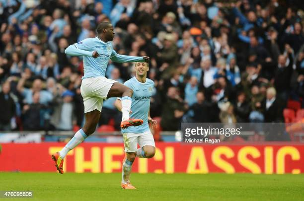 Yaya Toure of Manchester City celebrates his goal with Pablo Zabaleta of Manchester City during the Capital One Cup Final between Manchester City and...