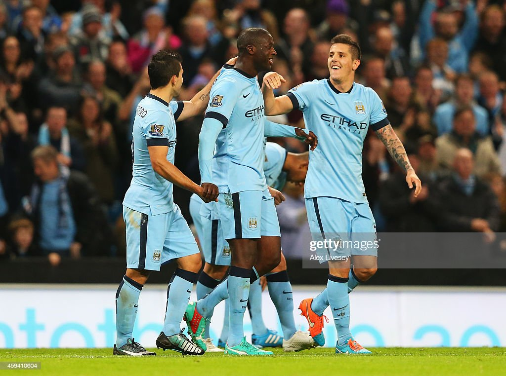 Yaya Toure of Manchester City celebrates his goal with team mates during the Barclays Premier League match between Manchester City and Swansea City at Etihad Stadium on November 22, 2014 in Manchester, England.