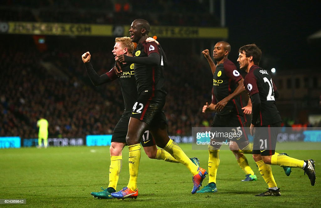 Yaya Toure of Manchester City (L) celebrates scoring his sides second goal with his Manchester City team mates during the Premier League match between Crystal Palace and Manchester City at Selhurst Park on November 19, 2016 in London, England.