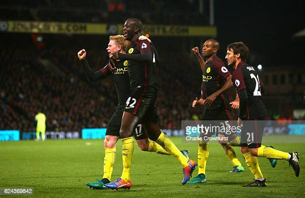 Yaya Toure of Manchester City celebrates scoring his sides second goal with his Manchester City team mates during the Premier League match between...