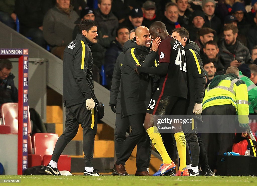 Yaya Toure of Manchester City (R) celebrates scoring his sides second goal with Josep Guardiola, Manager of Manchester City (L) during the Premier League match between Crystal Palace and Manchester City at Selhurst Park on November 19, 2016 in London, England.