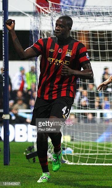 Yaya Toure of Manchester City celebrates scoring his sides third goal during the Barclays Premier League match between Queens Park Rangers and...