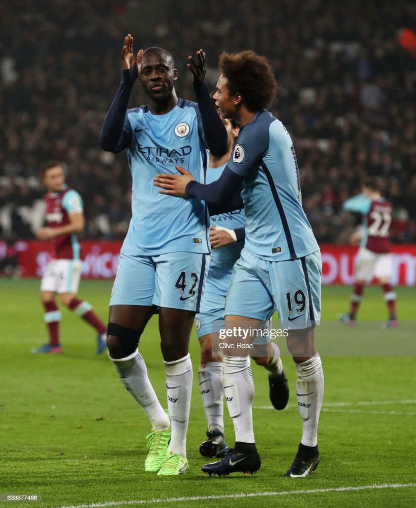Yaya Toure of Manchester City celebrates scoring his team's fourth goal with Leroy Sane during the Premier League match between West Ham United and Manchester City at London Stadium on February 1, 2017 in Stratford, England.