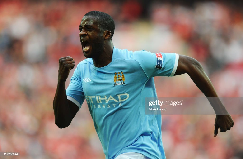 Yaya Toure of Manchester City celebrates scoring the opening goal during the FA Cup sponsored by E.ON semi final match between Manchester City and Manchester United at Wembley Stadium on April 16, 2011 in London, England.