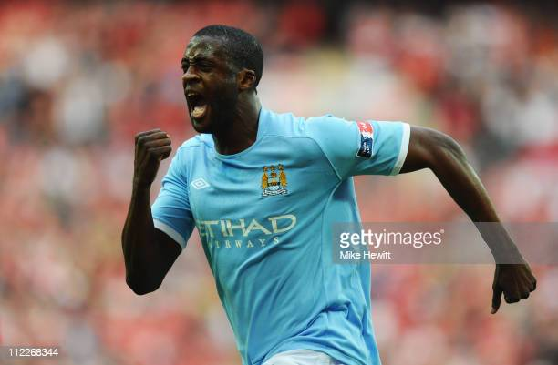 Yaya Toure of Manchester City celebrates scoring the opening goal during the FA Cup sponsored by E.ON semi final match between Manchester City and...