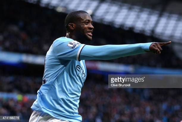 Yaya Toure of Manchester City celebrates scoring the opening goal during the Barclays Premier League match between Manchester City and Stoke City at...