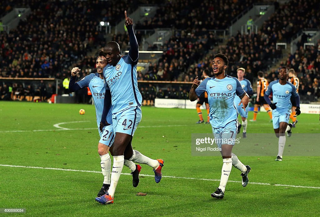 Yaya Toure of Manchester City celebrates scoring the opening goal with David Silva during the Premier League match between Hull City and Manchester City at KCOM Stadium on December 26, 2016 in Hull, England.