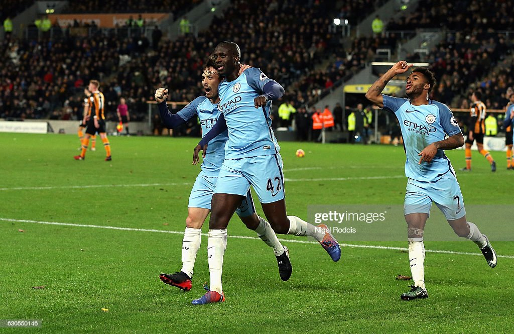 Yaya Toure of Manchester City celebrates scoring the opening goal with David Silva and Raheem Sterling during the Premier League match between Hull City and Manchester City at KCOM Stadium on December 26, 2016 in Hull, England.