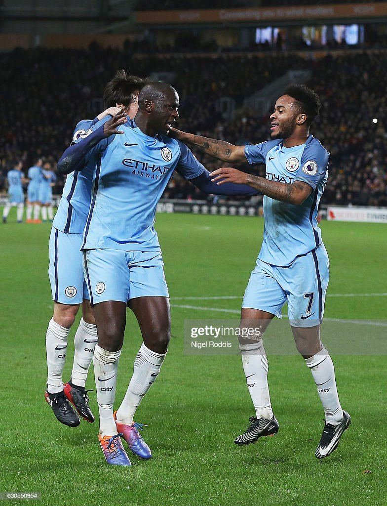 Yaya Toure of Manchester City celebrates scoring the opening goal with Raheem Sterling during the Premier League match between Hull City and Manchester City at KCOM Stadium on December 26, 2016 in Hull, England.