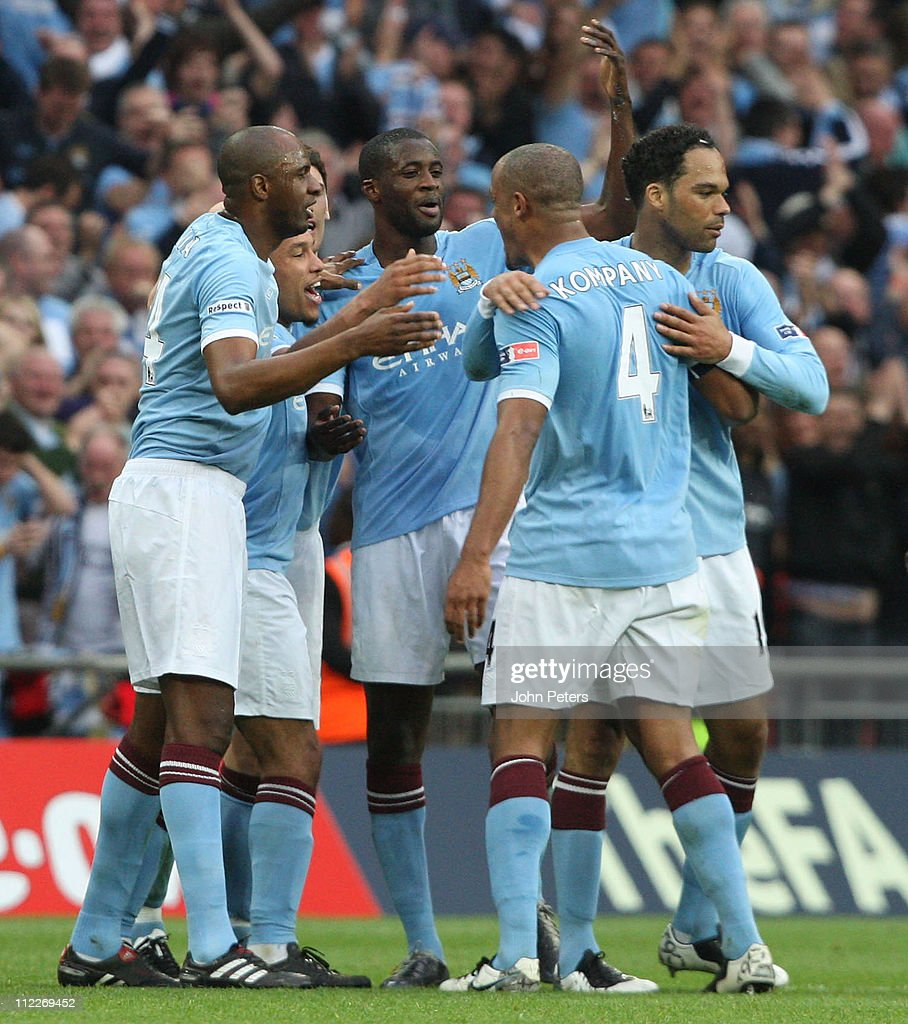 Yaya Toure (C) of Manchester City celebrates scoring their first goal during the FA Cup sponsored by E.on Semi-Final match between Manchester United and Manchester City at Wembley Stadium on April 16, 2011 in London, England.