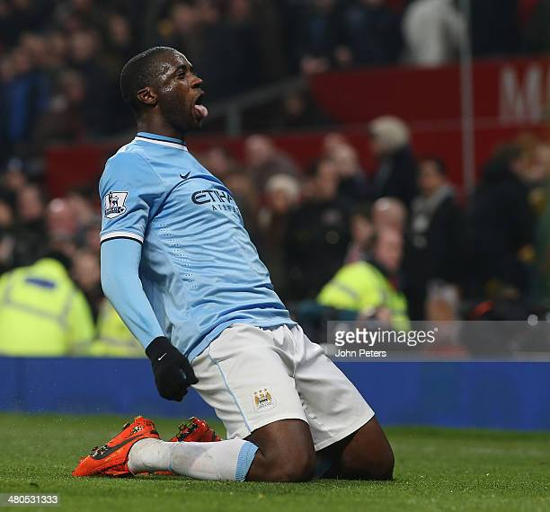 Yaya Toure of Manchester City celebrates scoring their third goal during the Barclays Premier League match between Manchester United and Manchester...