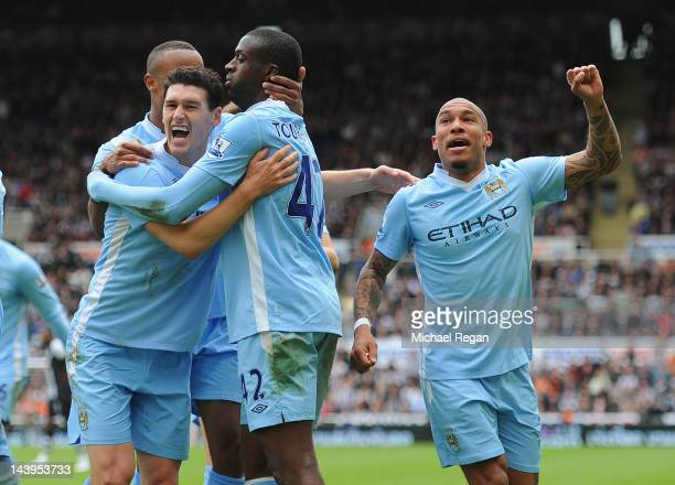 Yaya Toure of Manchester City celebrates scoring to make it 2-0 with team mates Nigel De Jong and Gareth Barry during the Barclays Premier League...